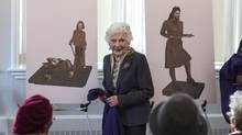 Peggy McAlpine, a 101-year-old World War II volunteer, unveils two of the three designs for monuments honouring women volunteers during the Second World War in Halifax on March 9, 2017. (Darren Calabrese/THE CANADIAN PRESS)