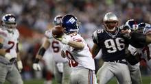 'How do you have Eli Manning scrambling for his life and throw that ball in the Super Bowl? … How do you capture that kind of playmaking in a test?' Cyrus Mehri, a lawyer who leads the Fritz Pollard Alliance, says of the New York Giants quarterback's clutch throw in the 2008 title game. (Julie Jacobson/AP)