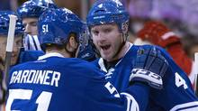 Toronto Maple Leafs defenceman Cody Franson (right) is congratulated by teammate Jake Gardiner after scoring on the Detroit Red Wings during first period NHL action in Toronto on Saturday, March 29, 2014. (The Canadian Press)