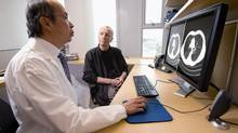 Dr. Stephen Lam and lung study participant Chris Douglas discuss the findings of a CT scan. (Chuck Russell/BC Cancer Agency)