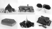 A series of twelve carvings were commissioned from local Inuit artists to document key Nunavut buildings and typologies from the 20th century.