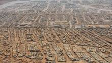 U.S. Secretary of State John Kerry made a brief visit to the Zaatari refugee camp, the second largest in the world, on Thursday. He heard from several residents frustrated with the international community's inability to bring the Syrian civil war to an end. (POOL/REUTERS)