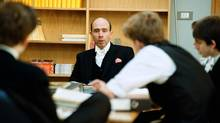 Eton teacher Henry Proctor holds a tutorial at Eton. The U.K.'s national teachers union is arguing that inequities between the fee-paying system and government-funded schools are growing. (PETER VAN DEN BERG/THE GLOBE AND MAIL)