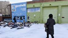 A woman, who was unaware of its closure, brings items to drop off at a the Goodwill donation centre at 231 Richmond St. East, Jan 18 2016. (Fred Lum/The Globe and Mail)