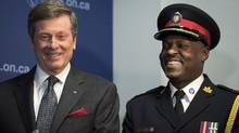 Toronto Mayor John Tory with police chief Mark Saunders on April 20. A potential end to carding in Toronto could trigger change elsewhere in the country. A Toronto police-committee review of street-check policies found that several Canadian police agencies use similar carding practices. (Darren Calabrese/THE CANADIAN PRESS)