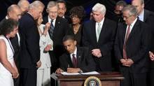 U.S. President Barack Obama signs the Dodd-Frank Wall Street Reform and Consumer Protection Act in Washington on July 21, 2010. (JIM YOUNG/REUTERS)