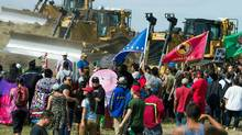 Activists opposed to the Dakota Access Pipeline confront bulldozers working on the new oil pipeline near Cannon Ball, North Dakota, Sept. 3, 2016. (ROBYN BECK/AFP/Getty Images)