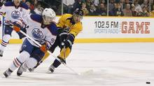 Nashville Predators' Nick Spaling (R) battles for the puck with Edmonton Oilers' Ryan Nugent-Hopkins (L) during the third period of their NHL hockey game in Nashville, Tennessee March 25, 2013. (HARRISON MCCLARY/REUTERS)