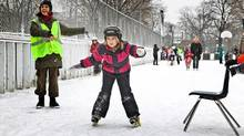 Fiona Bathelt, 7, races around the busy ice rink at the Dufferin Grove (Jennifer Roberts for The Globe and Mail/Jennifer Roberts for The Globe and Mail)