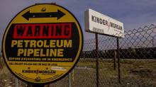 Kinder Morgan announced that it would shrink annual dividends to 50 cents a share from 2015's $1.93 level less than a month after a pledge to boost 2016 payouts. (David Paul Morris/Bloomberg)