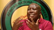 South African ANC Youth league President Julius Malema speaks during a press conference in Johannesburg in August. South Africa's ruling African National Congress today suspended Mr. Malema for five years after finding him guilty of provoking serious divisions within the party. (PABALLO THEKISO/PABALLO THEKISO/AFP/GETTY IMAGES)
