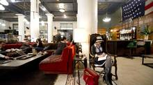 Patrons lounge in the lobby of the ACE Hotel lobby in Manhattan. (Jimmy Jeong For The Globe and Mail)