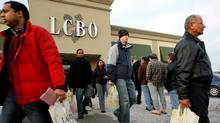 Customers line up at an Ontario liquor outlet (J.P. Moczulski/The Canadian Press)