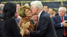 Interim Leader Bob Rae kisses Lise St-Denis, who crossed the floor from the NDP, as he arrives at Liberal Party's winter caucus meeting in Ottawa on Jan. 11, 2012. (Sean Kilpatrick/Sean Kilpatrick/The Canadian Press)