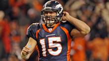 Denver Broncos quarterback Tim Tebow celebrates his 80-yard overtime touchdown pass, giving the Broncos a win over the Pittsburgh Steelers . It landed a spot on Twitter's most-tweets-per-second list. (AAron Ontiveroz/AAron Ontiveroz/AP)