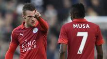 Leicester City's Jamie Vardy talks to Ahmed Musa during an FA Cup match against Millwall on Feb. 18, 2017. (Tony O'Brien/REUTERS)
