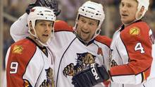 Florida Panthers defencemen Bryan McCabe (centre) and Jay Bouwmeester (4) congratulate centre Stephen Weiss (9) on his goal against the Toronto Maple Leafs in January (Frank Gunn)