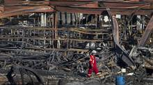 Twisted steel is all that remains of buildings along the main street in Lac-Mégantic, Que., on July 11, 2013. (MOE DOIRON/THE GLOBE AND MAIL)