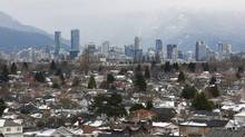 Houses in the Kitsilano neighbourhood and the downtown core are seen Vancouver, British Columbia. (CHRIS HELGREN/REUTERS)