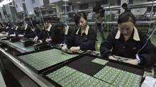 In this Nov. 22, 2008 photo, women work on an assembly line at a factory of Proview Technology in Wuhan, in central China's Hubei province. (AP)
