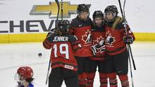 Canada's Erin Ambrose (23) celebrates with teammates after she scored a second period goal against Russia in the IIHF Ice Hockey Women's World Championship preliminary round game in Plymouth, Mich., on Monday, April 3, 2017. (Jason Kryk/THE CANADIAN PRESS)