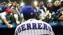 Montreal Expos rightfielder Vladimir Guerrero signs autographs before the team's final home game of the season against the Atlanta Braves in Montreal Wednesday, Sept. 17, 2003 (The Canadian Press)