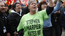 Hundreds of people march in downtown Ottawa in protest of federal budget cuts. (Adrian Wyld/Adrian Wyld/CP)