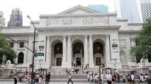 """This Friday, July 8, 2011 photo shows the New York Public Library during Celebrity Planet's """"Superhero Tour of New York"""" in New York. Celebrity Planet's walking tour of midtown Manhattan takes guests to landmarks where events in comic book history took place. (AP Photo/Tina Fineberg) (Tina Fineberg/AP)"""