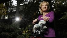 'He was always looking to give back,' Wendy Southall says of her late husband, Bill Volk, whose golf clubs she is holding. (Fred Lum/The Globe and Mail)