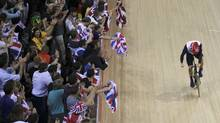 Britain's Chris Hoy is cheered by the crowd after he and his team mates won the track cycling men's team sprint finals at the Velodrome during the London 2012 Olympic Games August 2, 2012.