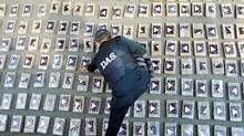 A Colombian intelligence services officer arranges packages of cocaine in Cali. Around 738 kg of drugs were seized during an operation in Yumbo province in Cauca, according to the authorities. (STRINGER/COLOMBIA/STRINGER/COLOMBIA/REUTERS)