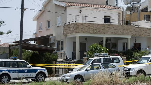 Cypriot police cordon off the house of a Lebanese man holding a Canadian passport in the Cypriot coastal city of Larnaca where more than 400 boxes of ammonium nitrate -- a fertiliser that when mixed with other substances can be used to make explosives -- was discovered (IAKOVOS HATZISTAVROU/AFP/Getty Images)