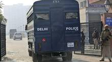 The men accused in the gang rape of a young woman in New Delhi are under tight police protection. (Manish Swarup/AP)