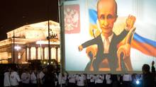 An animation of Russian Prime Minister Vladimir Putin near the Bolshoi Theater in Moscow to mark his 59th birthday on Oct. 7, 2011. (ANDREY SMIRNOV/AFP/Getty Images)