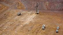 In this Jan. 29, 2014 photo, a drill finishes up the blast pattern at Barrick Gold Corp.'s Cortez Hills, Nev., open pit site. (Ross Andreson/THE CANADIAN PRESS)