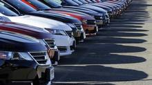 In this Wednesday, Sept. 18, 2013 photo Chevrolet passenger cars form a row on a dealer's lot. (STEVEN SENNE/THE ASSOCIATED PRESS)