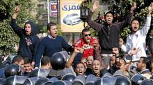 Angry Egyptian protestors shout anti-government slogans during a protest in Suez, Egypt on Jan. 27, 2011. (str/The Associated Press)