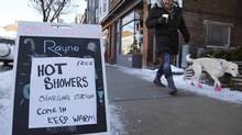 A Danforth Avenue spa advertises free hot showers for those without power on Wednesday, Dec. 25, 2013. (CHRIS HELGREN/REUTERS)