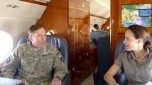 David Petraeus, former Central Intelligence Agency Director, with Paula Broadwell, the author of his biography, flying to Helman Province, Afghanistan in June 2011, in a handout photo. Petraeus resigned as director of the CIA Nov. 9, 2012, after issuing a statement saying that he had engaged in an extramarital affair. Administration and Congressional officials identified Broadwell as the woman with whom Petraeus was having the affair. (COMMAND SGT. MAJ. MARVIN L HILL/NYT)