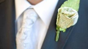 A boutonniere made from a folded road map adorns a lapel at a recent U.S. wedding