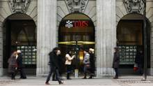 For UBS employees who earn more than $250,000 (U.S.), 30 per cent or more of their bonuses for 2012 will take the form of contingent-capital bonds. If a key measure of the bank's financial health dips below a certain level – or if the bank goes under – then those bonds get wiped out. (MICHAEL BUHOLZER/REUTERS)