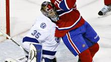Montreal Canadiens center Louis Leblanc (71) collides with Tampa Bay Lightning goalie Sebastien Caron (35) during third period of NHL hockey action in Montreal, April 4, 2012. (OLIVIER JEAN/REUTERS)