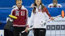 Canada skip Rachel Homan, right, and Russia skip Anna Sidorova watch a replay on the overhead screen at the Ford World Women's Curling Championships in Saint John, N.B. on Saturday, March 15, 2014. (Andrew Vaughan/THE CANADIAN PRESS)