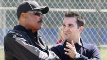 Toronto Blue Jays GM Alex Anthopoulos, right, and manager Cito Gaston chat during workouts at the Blue Jays' spring training baseball facility in Dunedin, Fla. Sunday, February 28, 2010. (Darren Calabrese/THE CANADIAN PRESS)