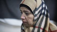Syrian refugee Khitam, from the Daraa province, left her home along with her husband and two children after their neighbour's house was hit by a missile Nov. 28, 2015. Khitam broke down into tears over sadness at what she's lost and anxiety over what's ahead in Canada. (Annie Sakkab/Annie Sakkab)