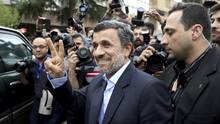 Former Iranian President Mahmoud Ahmadinejad flashes the victory sign as he arrives at the Interior Ministry to register his candidacy for the upcoming presidential elections, in Tehran, Iran, Wednesday, April 12, 2017. (Ebrahim Noroozi/AP)