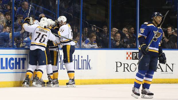 Nashville Predators players celebrate after scoring the game-winning goal in Game 1 of their series against the Blues in St. Louis on Wednesday.