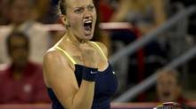 Petra Kvitova from the Czech Republic celebrates a point over Li Na from China during the final at the Rogers Cup tennis tournament Monday, August 13, 2012 in Montreal. (Paul Chiasson/THE CANADIAN PRESS)