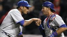 Toronto Blue Jays relief pitcher Sergio Santos, left, congratulates catcher J.P. Arencibia after the Blue Jays defeated the Cleveland Indians 7-4 in 16 innings. (Amy Sancetta/AP)