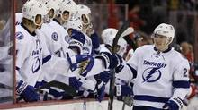 Tampa Bay Lightning defenceman Matt Carle celebrates with teammates after scoring a goal during a shootout against the Washington Capitals at Verizon Center. (Geoff Burke/USA Today Sports)